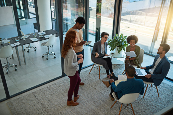 Shot of a group of creatives having a meeting in a modern office